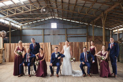 bridal party posing in woolshed country wedding de lumiere photography