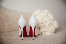 white christian louboutin wedding shoes with bouquet
