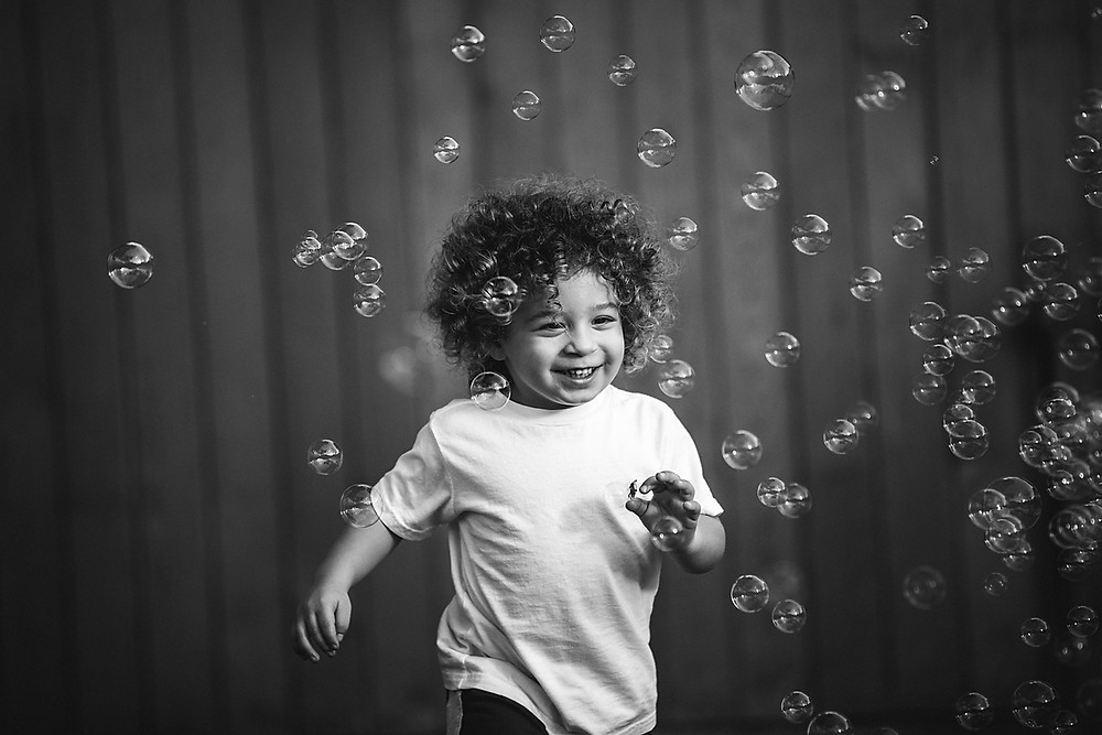little boy happy bubbles in-home family portraits