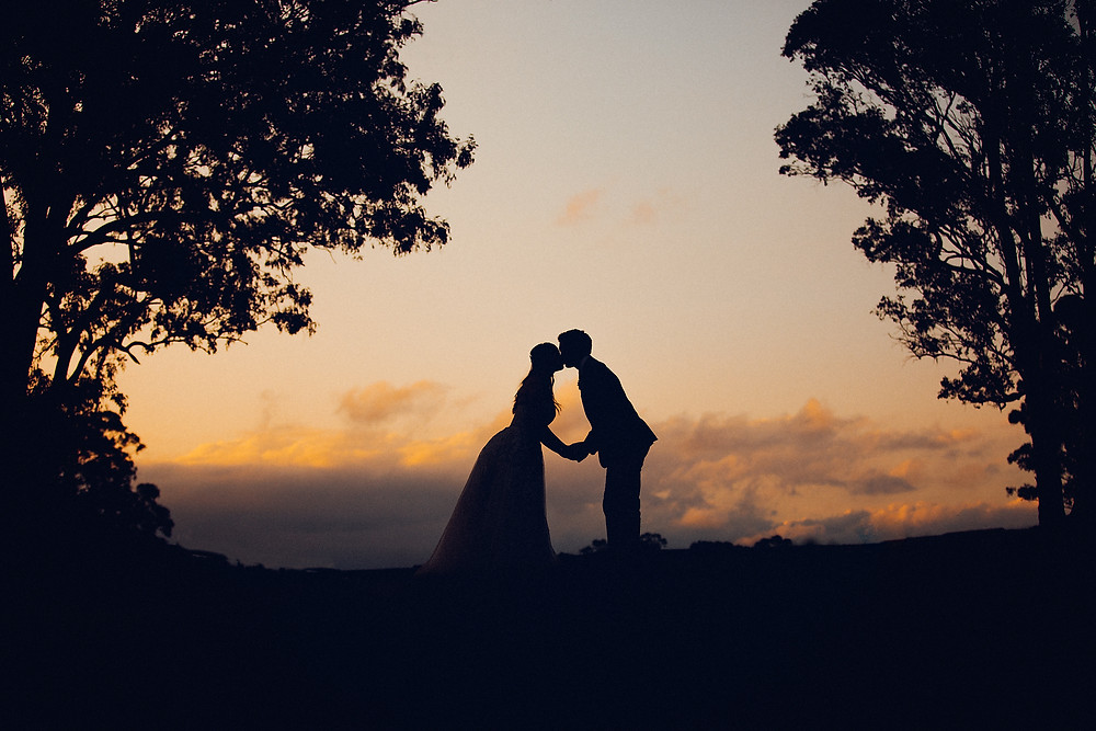 romantic silhouette bride and groom de lumiere photography