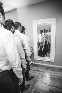 Reflection of the bridal party photographed by de lumière photography