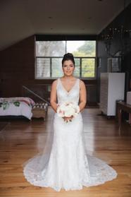 Bride holding bouquet by de lumière photography