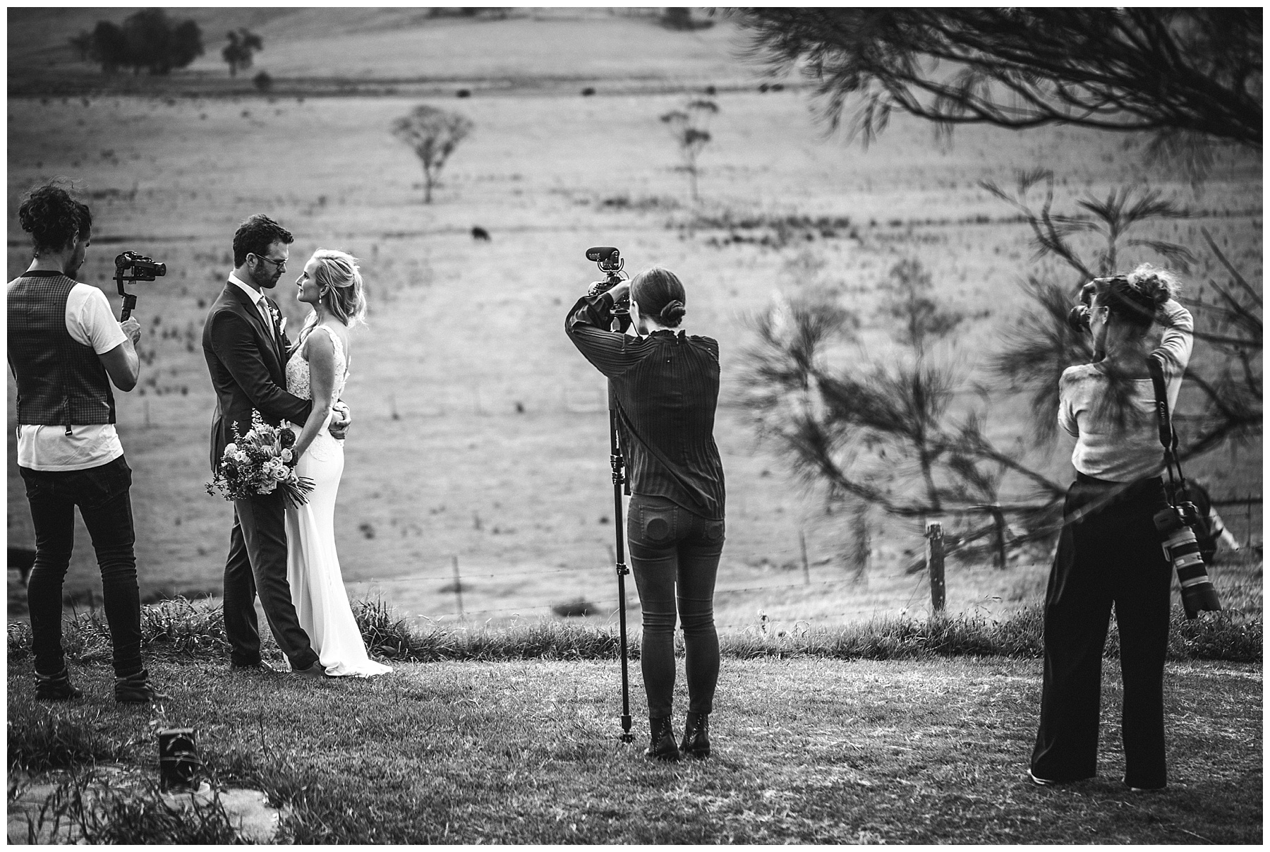 Videographers and photographer at work on wedding day