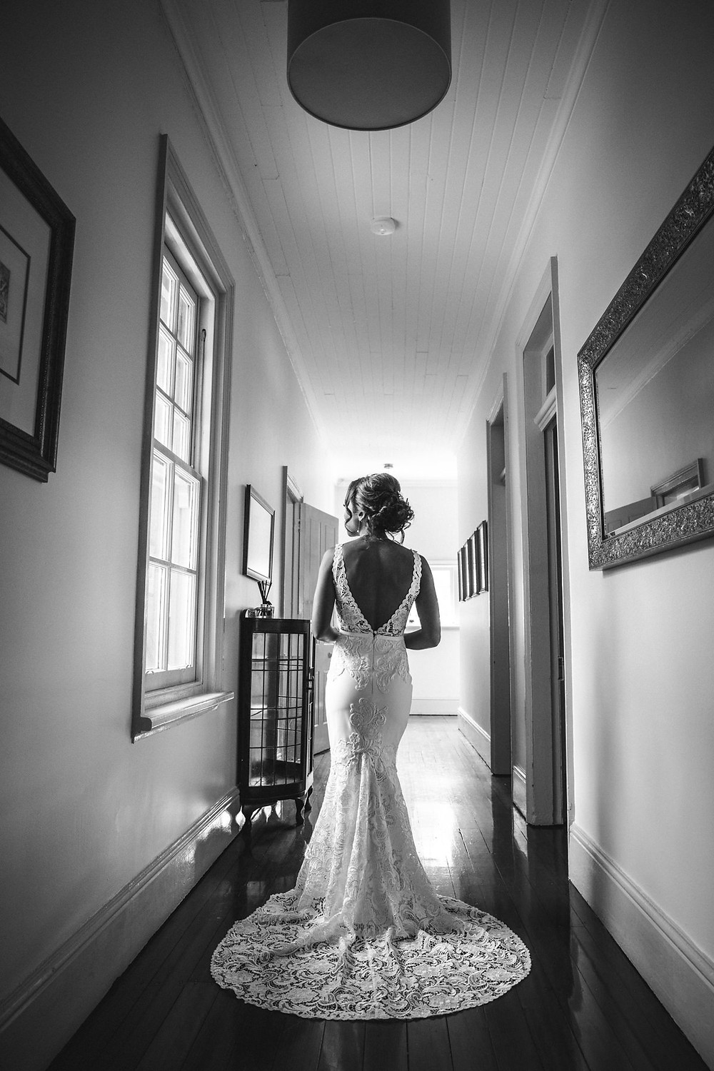 black and white image of bride in her wedding dress