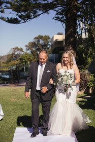Father walks his daughter down the aisle
