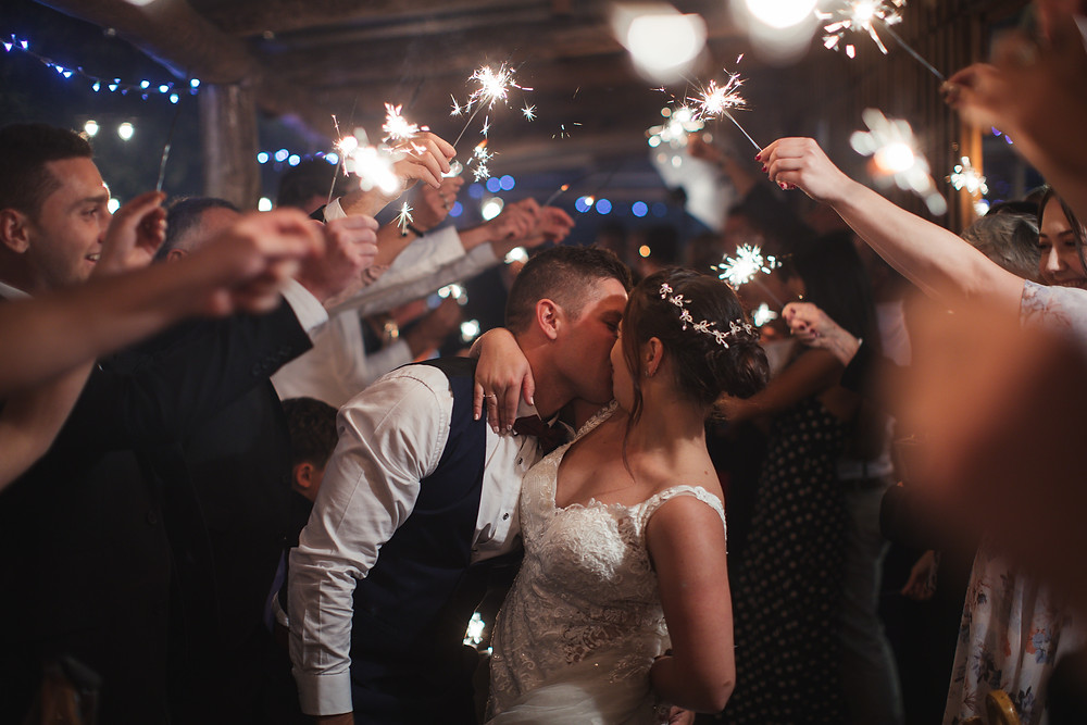couple kissing under a sparkler arch country wedding photographer