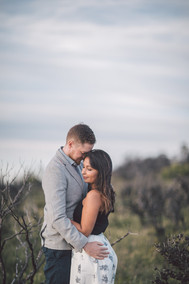 Woman with eyes closed being held by her boyfriend
