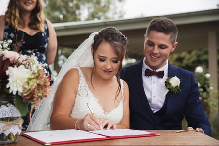 bride signing wedding register country wedding de lumiere photography