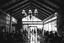 Black and white photograph of the indoor wedding ceremony - de lumière photography