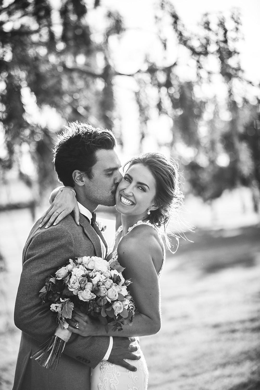 attractive couple kissing sydney wedding photographer