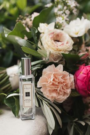 Jo Malone perfume bottle with bridal bouquet photographed by de lumière photography