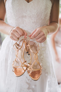 professional wedding photographer de lumiere photography of brides shoes