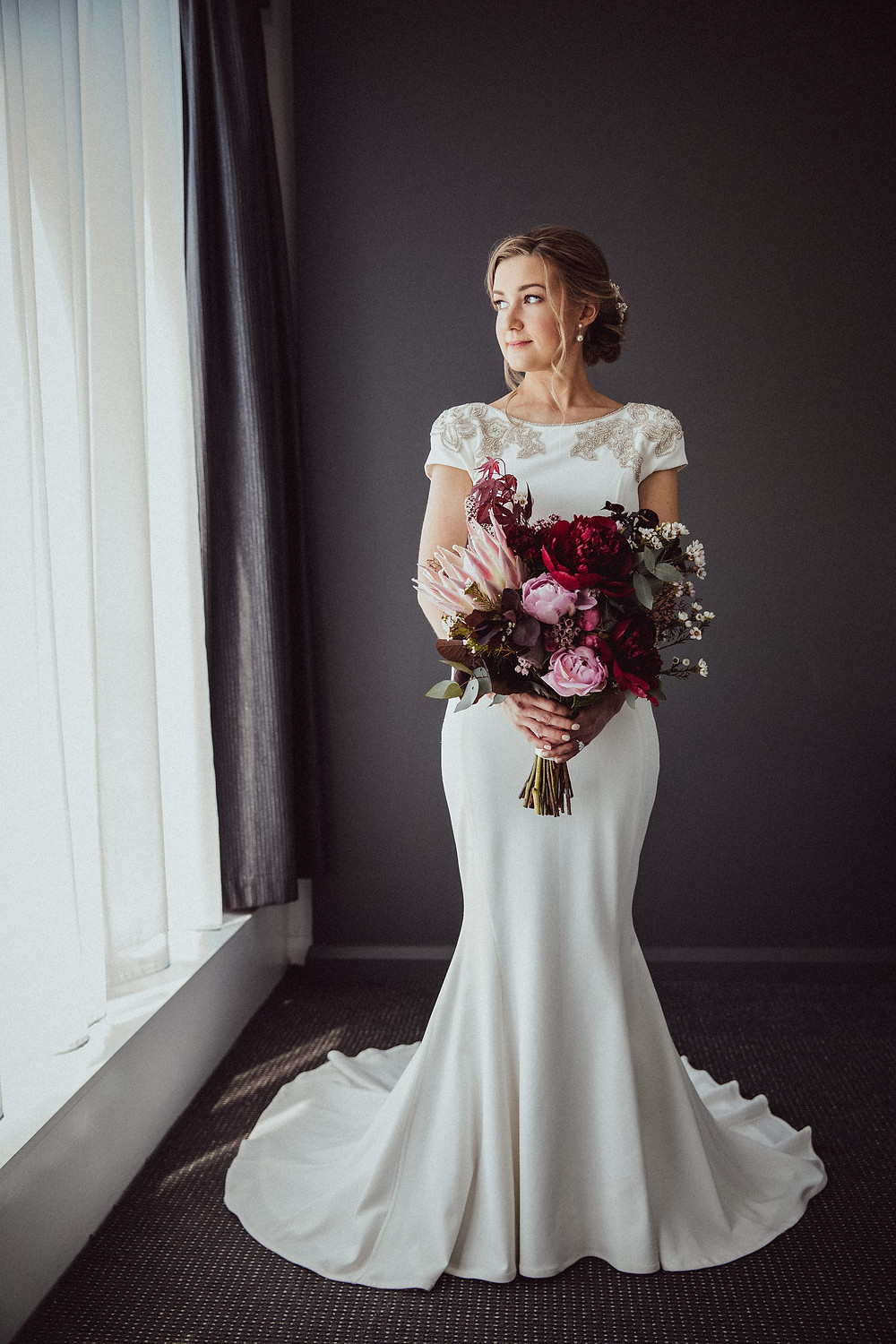 bride wearing elegant rachel gilbert gown