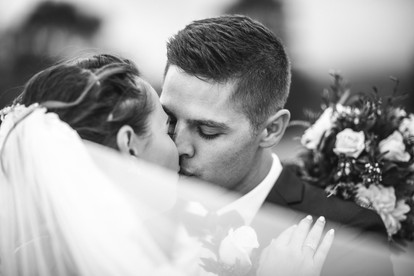 bride and groom kiss with veil country wedding de lumiere photography