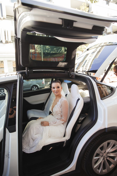 The bride arrives in her Tesla Wedding Car