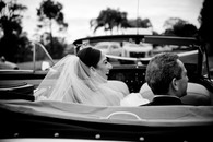father and daughter in back of wedding car