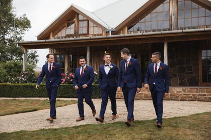 Groom and groomsmen walking country wedding de lumiere photography