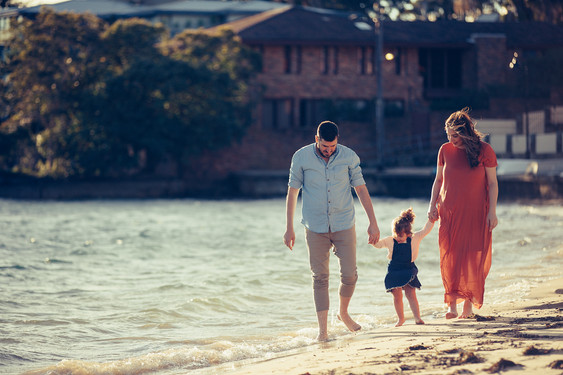 Family walking together on Watsons Bay beach