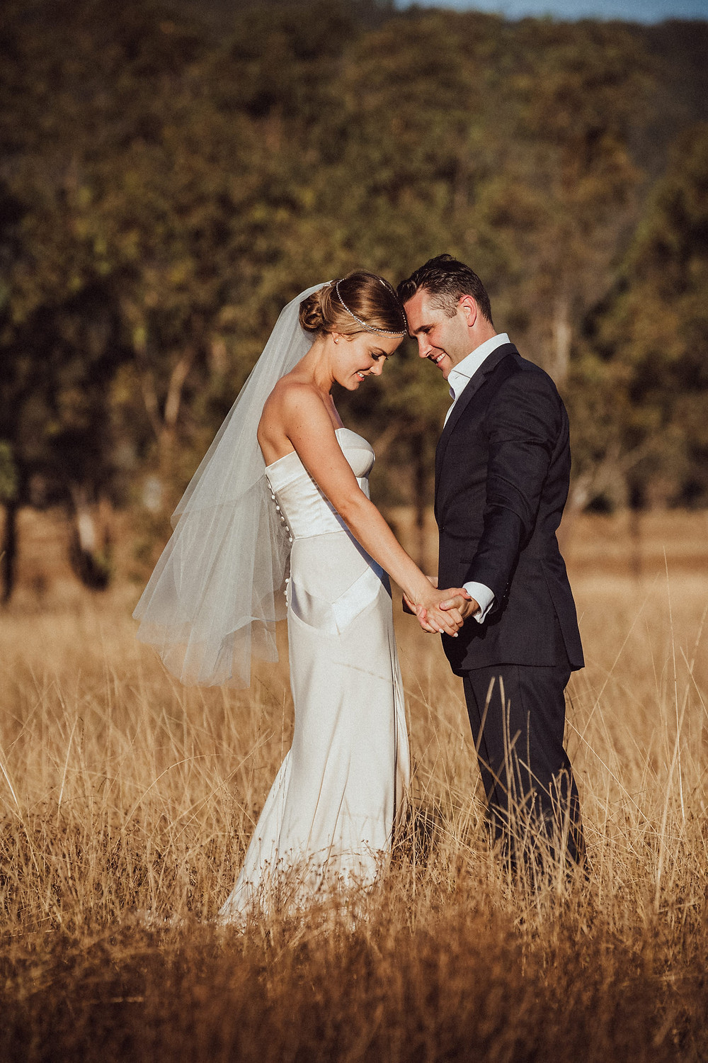 romantic moment between bride and groom at country wedding