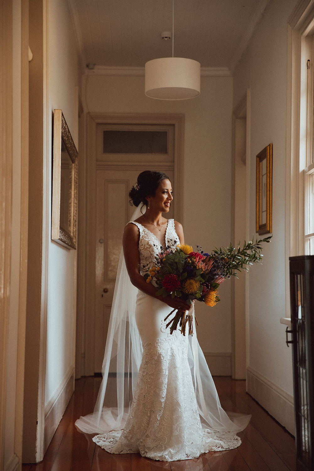 bride holding bouquet by beautiflor