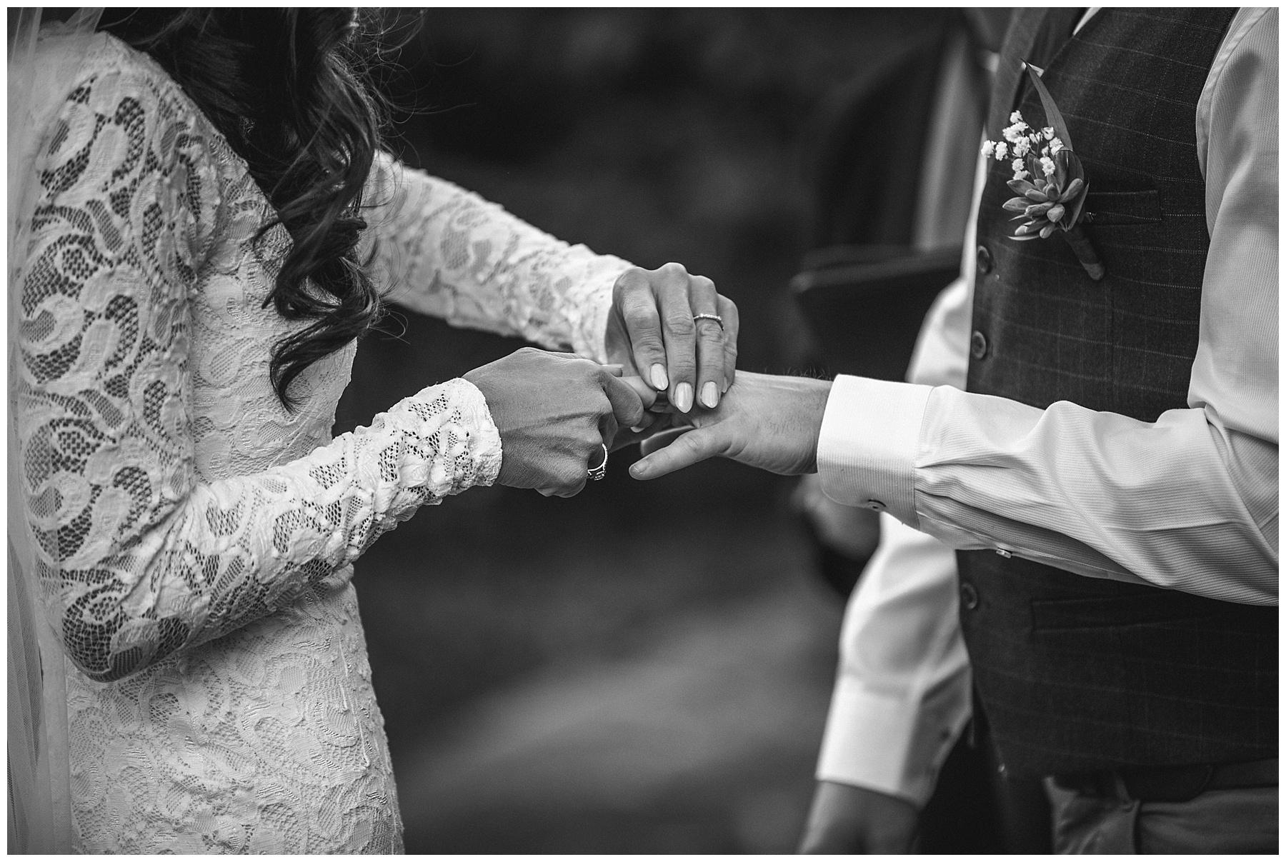 The bride struggling to put the grooms ring on his finger - de lumière photography