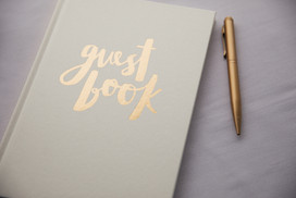 White wedding guest book with gold pen - de lumière photography