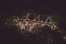 professional wedding photographer outdoor wedding location with fairy lights