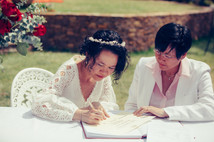 professional wedding photography the bride's signing their wedding certificate
