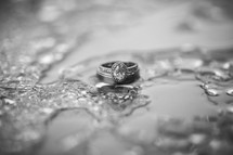 Engagement ring photographed in the rain - Sydney Wedding Photographers de lumière photography