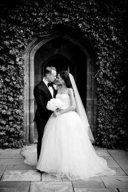 bride and groom in ivy covered arch at sydney university