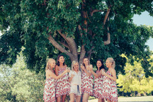 professional wedding photography of bride and her bridesmaids celebrating with champagne