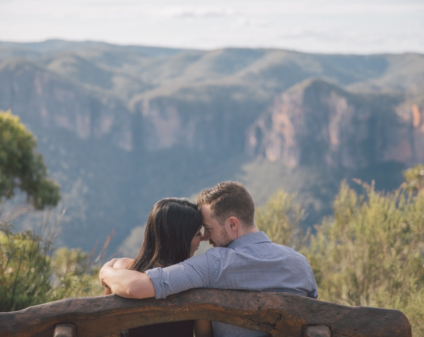 Close up of couple hugging on seat
