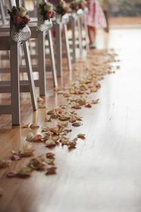 Flower petals strewn down the aisle