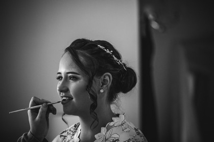 bride having makeup done country wedding photographer