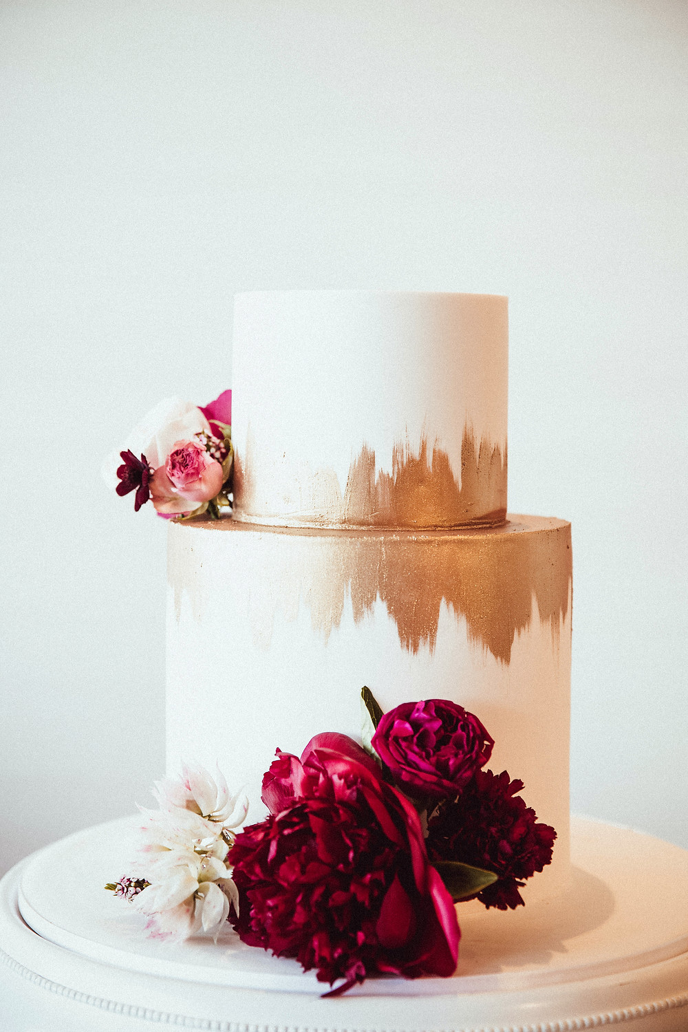 classic white and gold faye cahill wedding cake