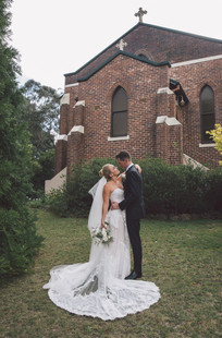 the bride and groom share an intimate moment outside the church