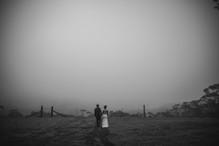 Bride and groom walking into the mist - Sydney Wedding Photographers de lumière photography