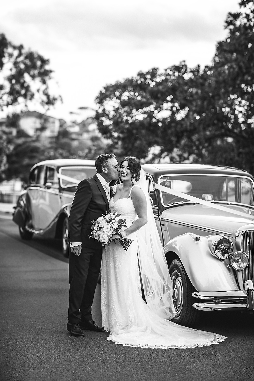 groom kissing bride dunbar house wedding de lumiere photography