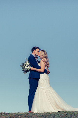 Bride and Groom Kissing photographed by de lumiere photography
