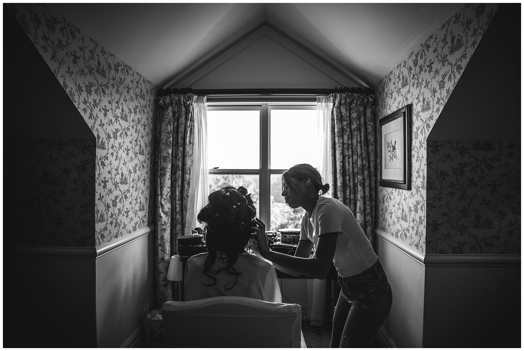 Hair and Make Up Artist applying the finishes touches to the bride - de lumière photography