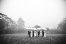 Bridal party under umbrellas walking through the mist - Sydney Wedding Photographer de lumière photography