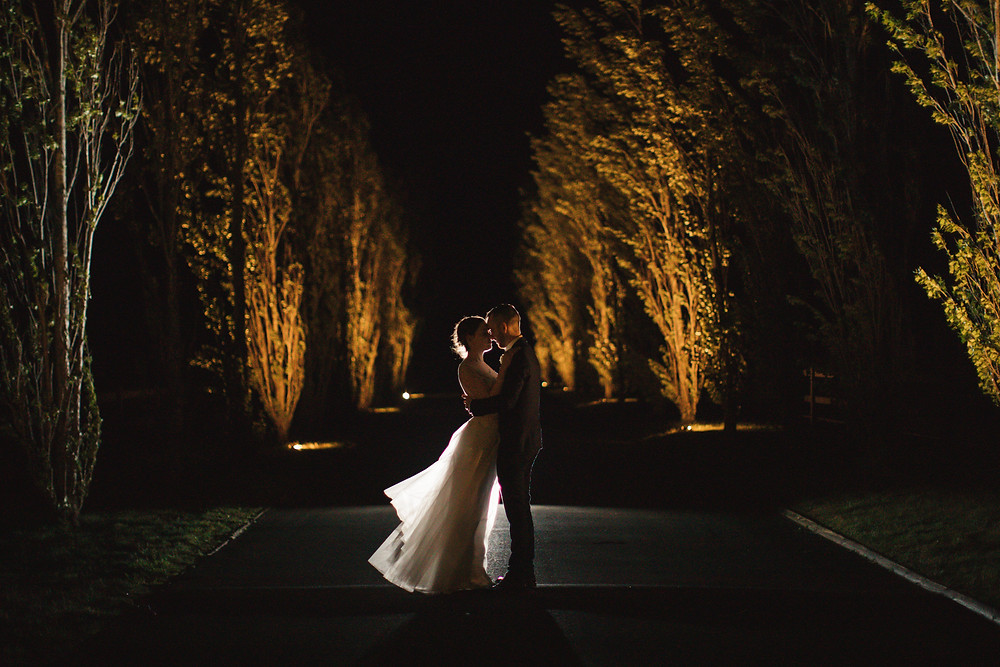 Couple embracing at night, Bendooley Estate
