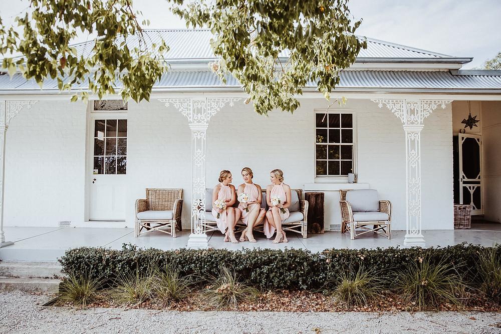 bridesmaids wearing blush pink dresses at farm wedding