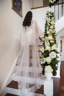 bride walking up stairs with veil