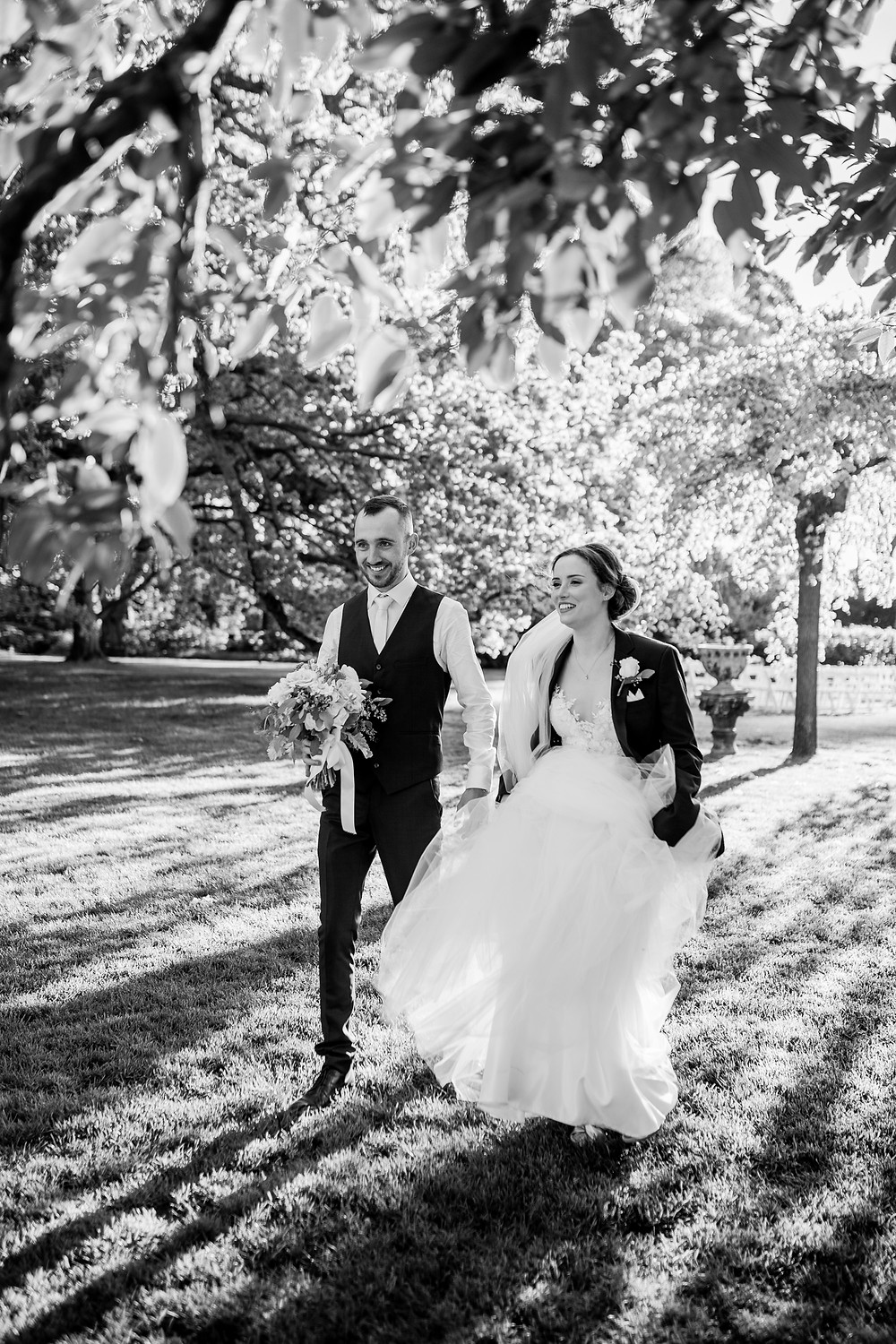 Bride and groom enjoying a stroll at Bendooley Estate