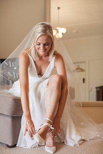 professional wedding photography of bride putting on her asos shoes