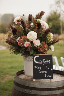 confetti sign and flowers country wedding de lumiere photography