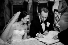 the bride and groom signing the wedding register