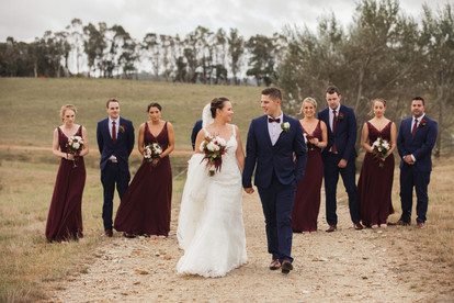 bridal party walking in paddock country wedding de lumiere photography