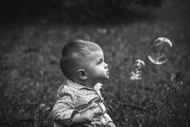 Black and white image of child and bubbles